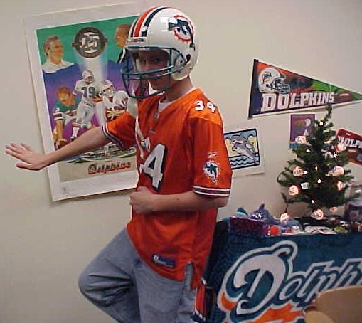 Caleb Peters, a big Dolphins fan, does the Heismann pose on 12-17-07!