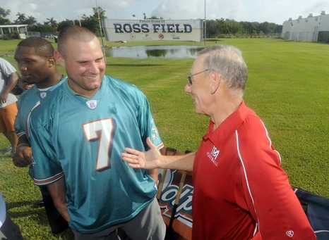 Owner Ross visits with QB Chad Henne